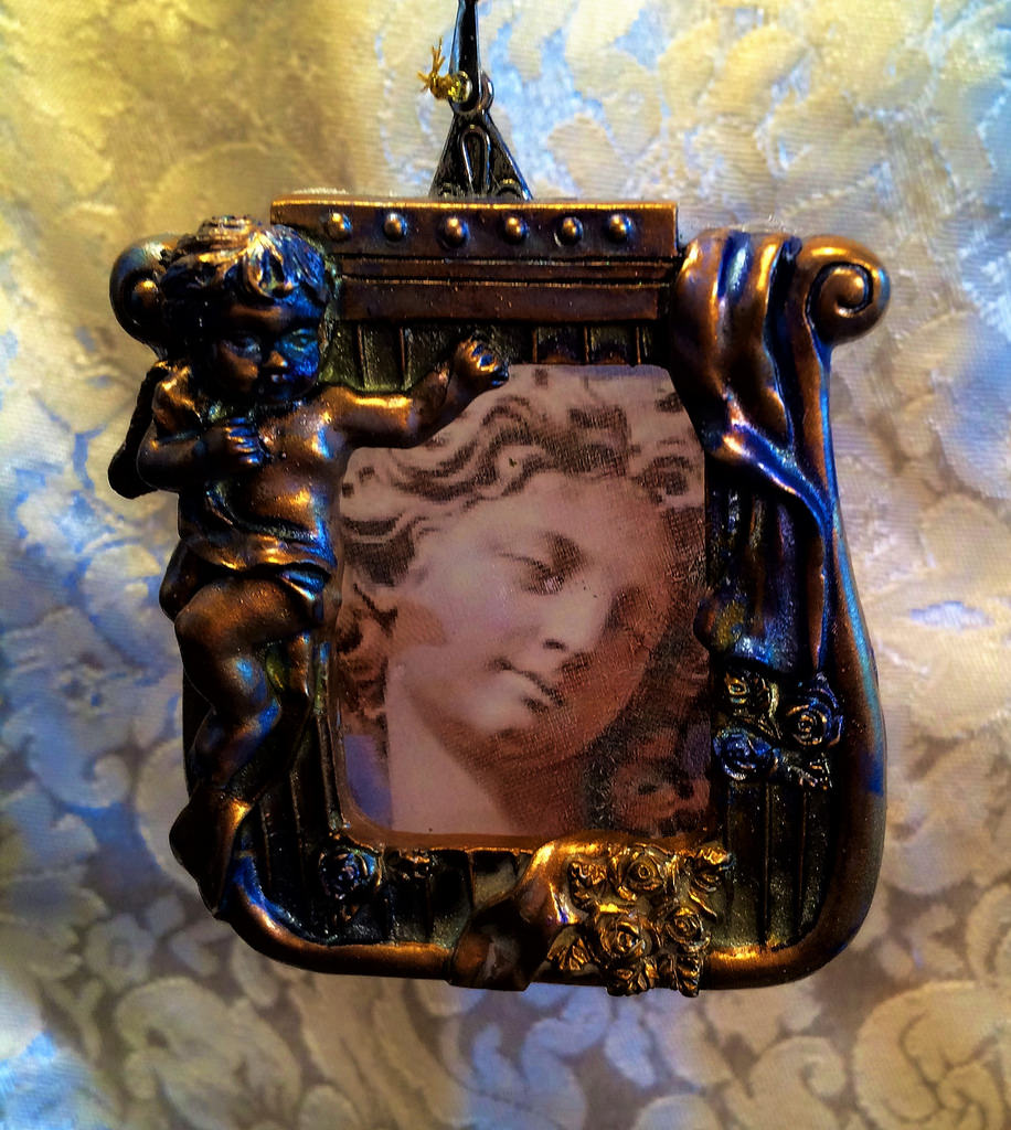 Bernini-angel-in-a-frame-@.5-x-2.534